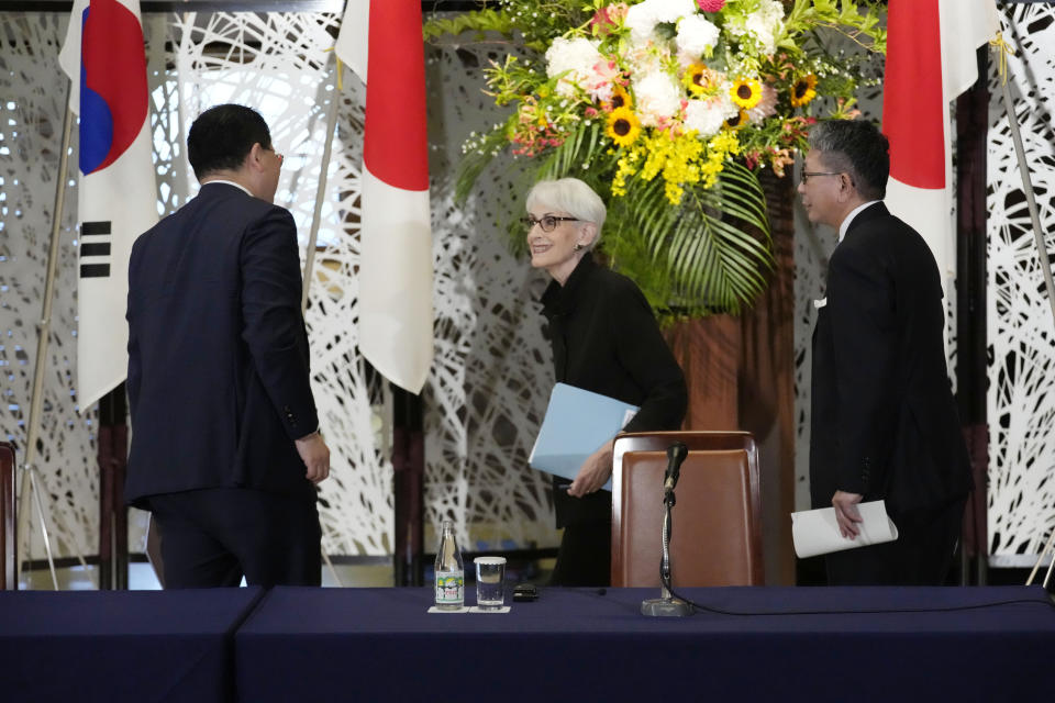 U.S. Deputy Secretary of State Wendy Sherman, center, South Korean First Vice Foreign Minister Choi Jong Kun, left, and Japanese Vice-Minister for Foreign Affairs Takeo Mori walk away after a press conference of their trilateral meeting at the Iikura Guesthouse Wednesday, July 21, 2021, in Tokyo. (AP Photo/Eugene Hoshiko)