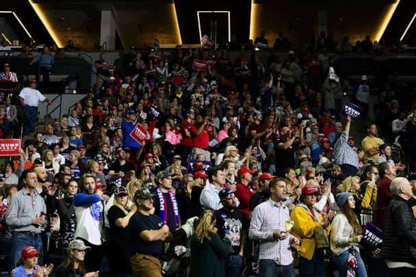 PHOTO: Attendees listen as President Donald Trump speaks on stage during a campaign rally at the Target Center on Oct. 10, 2019 in Minneapolis, Minn. (Stephen Maturen/Getty Images)