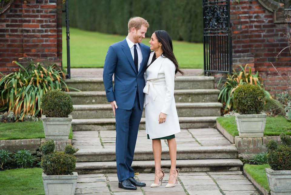 """<p>Meghan's look was way more buttoned up than her first photo op with Prince Harry at the Invictus Games. The actress was <a rel=""""nofollow"""" href=""""https://www.yahoo.com/lifestyle/meghan-markle-shamed-wearing-ripped-jeans-155420729.html"""" data-ylk=""""slk:shamed for wearing ripped jeans;outcm:mb_qualified_link;_E:mb_qualified_link;ct:story;"""" class=""""link rapid-noclick-resp yahoo-link"""">shamed for wearing ripped jeans</a>. But theirs is a modern royal romance. She's been married before, so <a rel=""""nofollow"""" href=""""https://www.yahoo.com/lifestyle/people-explains-meghan-markle-married-130656635.html"""" data-ylk=""""slk:look for them to have a much more low-key wedding;outcm:mb_qualified_link;_E:mb_qualified_link;ct:story;"""" class=""""link rapid-noclick-resp yahoo-link"""">look for them to have a much more low-key wedding</a> than Prince William and Kate Middleton had. Being the """"spare"""" and not the heir allows for that, anyway. (Photo: Chris Jackson/Getty Images) </p>"""