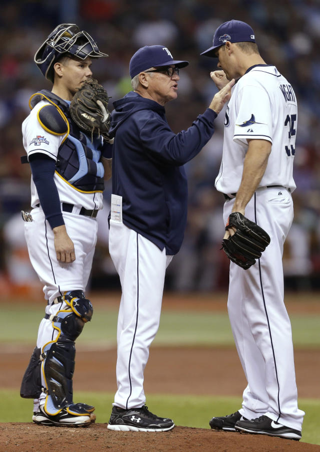 Tampa Bay Rays manager Joe Maddon, center, speaks to pitcher Jamey Wright (35) as catcher Jose Lobaton (59) listens during the second inning in Game 4 of an American League baseball division series against the Boston Red Sox, Tuesday, Oct. 8, 2013, in St. Petersburg, Fla. Wright removed Hellickson from the game. (AP Photo/Chris O'Meara)