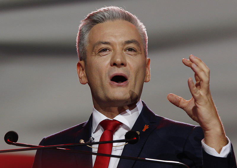 FILE - In this Sunday, Feb. 3, 2019 file photo Robert Biedron addresses the founding convention of his new centre-left party 'Wiosna' (Spring), in Warsaw, Poland. The left-wing party leader in Poland has won praise across the political spectrum for rescuing a 2-year-old boy and his father from a burning car. The accident occurred Monday evening in Tabor, south of Warsaw, when a car collided with a truck and began to burn. (AP Photo/Czarek Sokolowski)