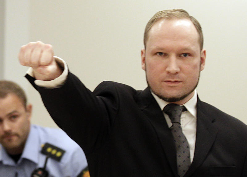 Mass murderer Anders Behring Breivik, makes a salute after  he arrives at the court room in a courthouse in Oslo  Friday Aug. 24, 2012 . Breivik has been declared sane and sentenced to prison for bomb and gun attacks that killed 77 people last year. (AP Photo/Frank Augstein)
