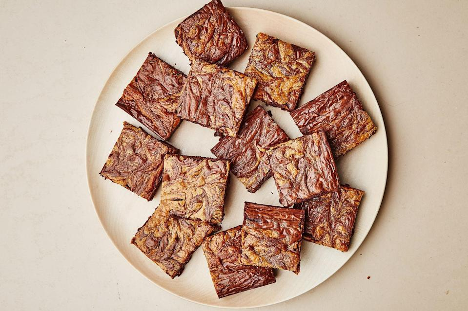 """Your brownies need a savory swirl of tahini. Dragging a toothpick through to make pretty designs is part of the fun. <a href=""""https://www.epicurious.com/recipes/food/views/gluten-free-chocolate-tahini-brownies?mbid=synd_yahoo_rss"""" rel=""""nofollow noopener"""" target=""""_blank"""" data-ylk=""""slk:See recipe."""" class=""""link rapid-noclick-resp"""">See recipe.</a>"""