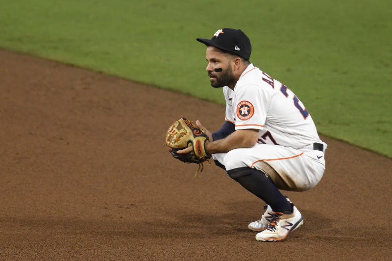 Houston Astros second baseman Jose Altuve reacts to his third throwing error during the ALCS. (Photo by Harry How/Getty Images)