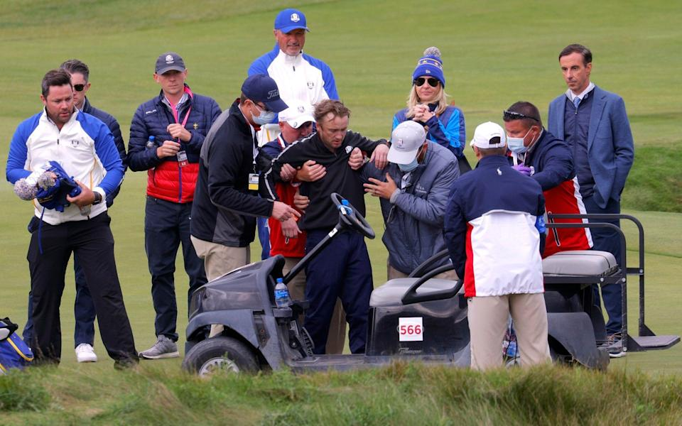 Tom Felton is helped into a golf buggy - REUTERS