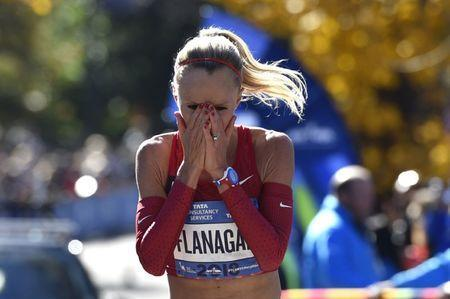 Nov 4, 2018; New York, NY, USA; Shalane Flanagan reacts after crossing the finish line in third place in the professional women's division of the 2018 TCS New York City Marathon. Mandatory Credit: Derik Hamilton-USA TODAY Sports