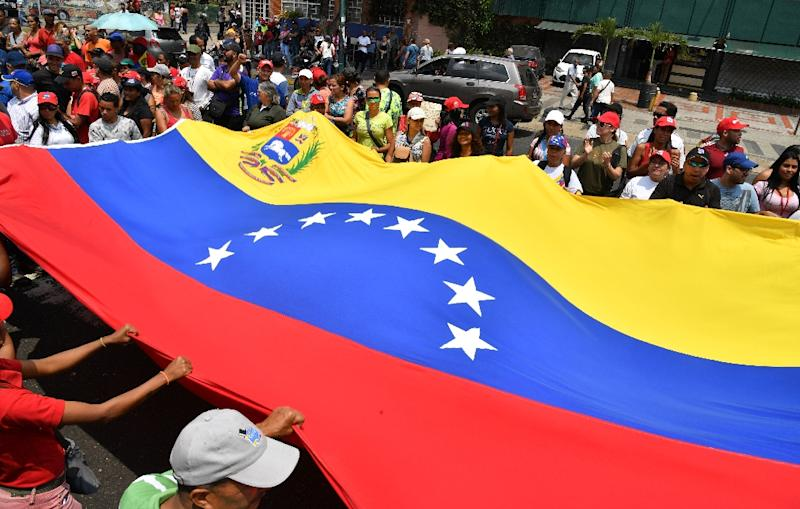 Supporters of Venezuela's Nicolas Maduro march in Caracas show their support for the socialist regime (AFP Photo/Yuri CORTEZ)
