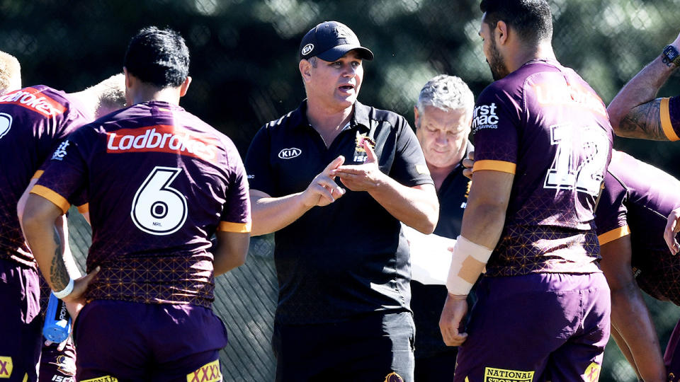 Coach Anthony Seibold gives instructions to the Brisbane Broncos players.