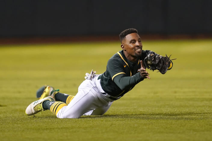 Oakland Athletics left fielder Tony Kemp catches a lineout hit by Seattle Mariners' Jarred Kelenic during the eighth inning of a baseball game in Oakland, Calif., Wednesday, Sept. 22, 2021. (AP Photo/Jeff Chiu)