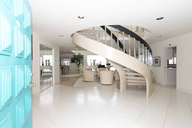 In the foyer is an interesting spiral staircase.