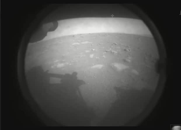The first image captured by NASA's Perseverance Mars Rover, which landed on the Red Planet on Thursday.