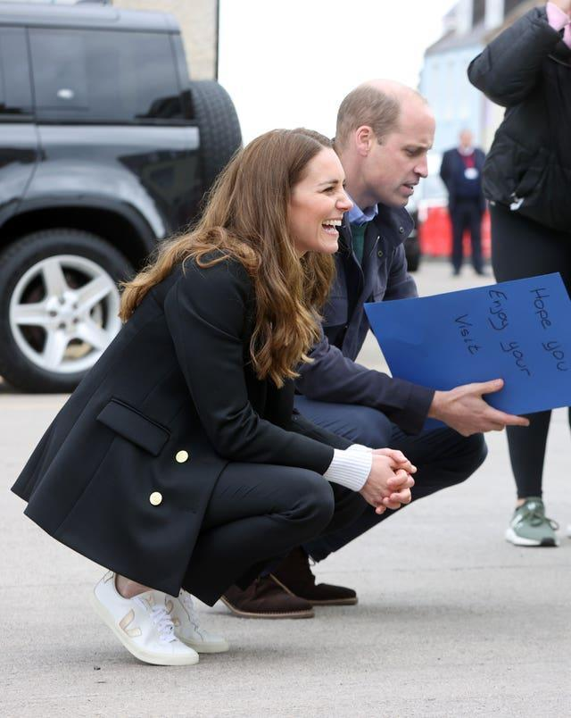 The Duke and Duchess of Cambridge speak with young children during a meeting with fishermen on their visit to Fife (Chris Jackson/PA)