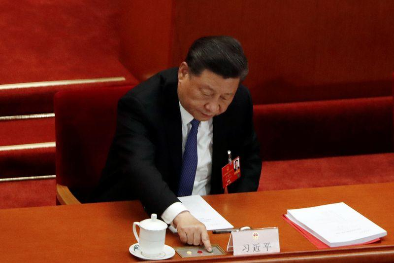 Chinese President Xi Jinping casts his vote on the national security legislation for Hong Kong Special Administrative Region at the closing session of NPC in Beijing