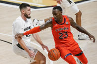 Central Florida forward Sean Mobley, left, loses control of the ball as he tries to get around Auburn forward Jaylin Williams (23) during the second half of an NCAA college basketball game, Monday, Nov. 30, 2020, in Orlando, Fla. (AP Photo/John Raoux)