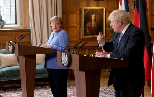 Prime Minister Boris Johnson and the Chancellor of Germany, Angela Merkel, during a press conference after their meeting at Chequers