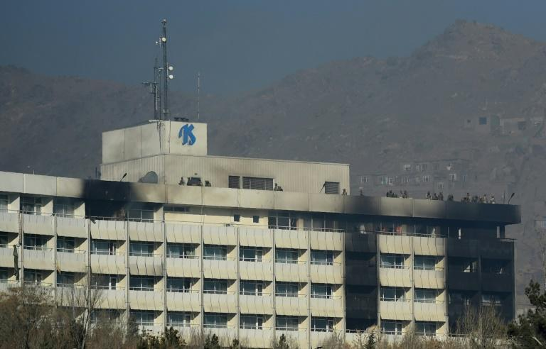 Afghan security personnel took positions on the roof of the Intercontinental Hotel during the fight between gunmen and security forces