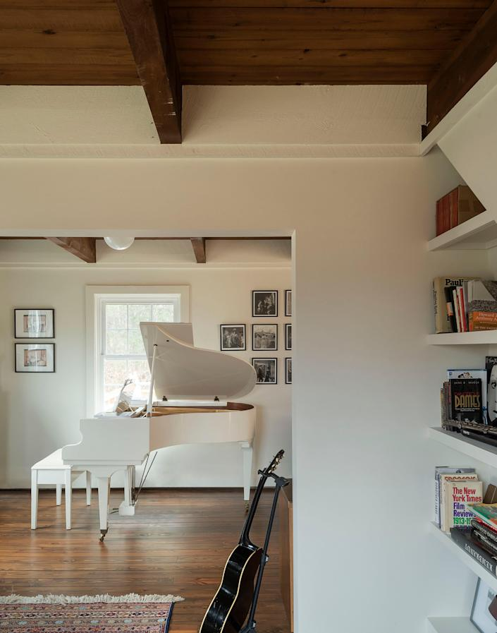 AFTER: Both homeowners are professional actors who use the home to develop ideas and entertain. The music room is one of the brightest rooms in the house and it features a vintage white piano that was passed down from the mother of one of the homeowners.