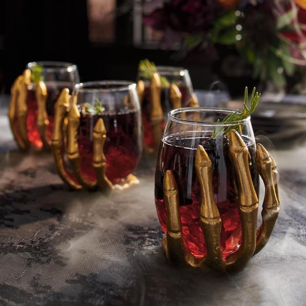 <p>Sipping wine has never tasted better than out of these <span>Skeleton Hand Wine Glasses</span> ($70).</p>