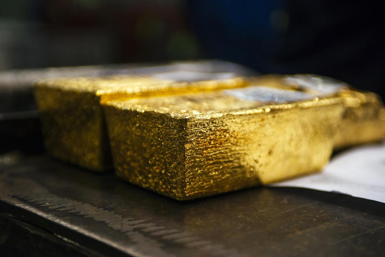 Gold bullion bars sit following casting at a refinery in Germiston, South Africa. Photographer: Waldo Swiegers/Bloomberg
