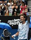Tomas Berdych of the Czech Republic celebrates after defeating Rafael Nadal of Spain in their quarterfinal match at the Australian Open tennis championship in Melbourne, Australia, Tuesday, Jan. 27, 2015. (AP Photo/Andy Brownbill)