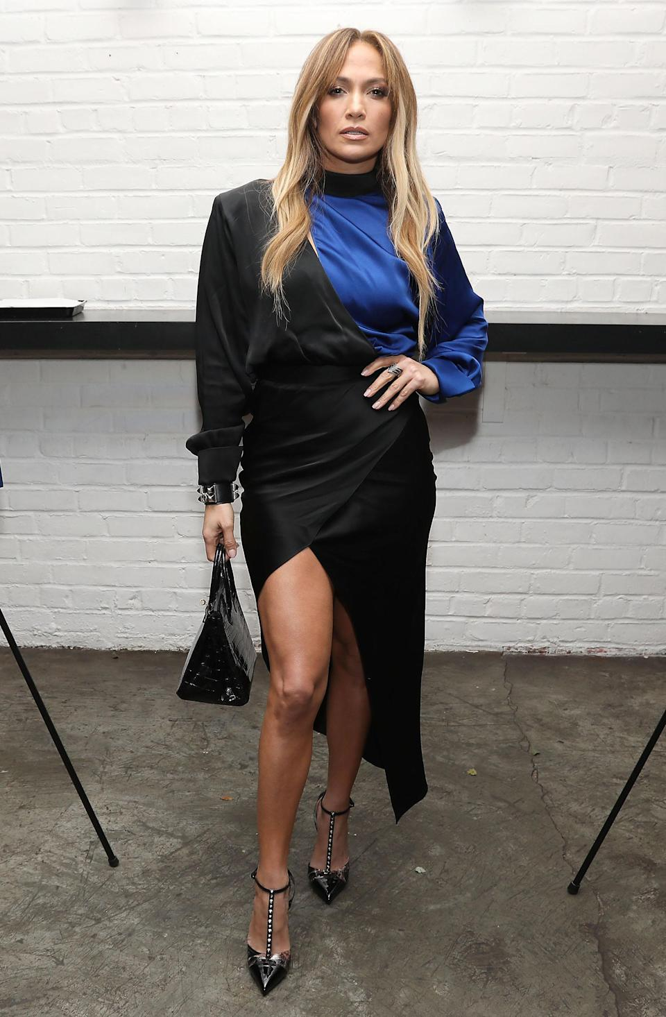 <p>On November 26, Jennifer Lopez reminded us why she's still our go-to style muse in a thigh-split dress and Valentino heels. <em>[Photo: Rex]</em> </p>
