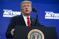 US President Donald Trump is seen in this file photo from June 23, 2020 speaking to a large group of students in Phoenix, Arizona; as usual, he did not wear a mask