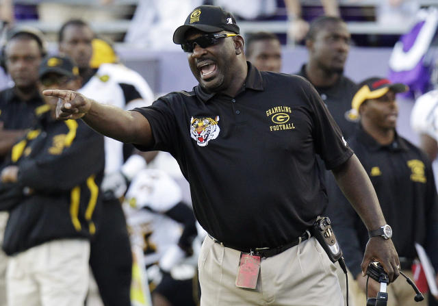 FILE - In this Sept. 8, 2012, file photo, Grambling State coach Doug Williams yells from the sideline during an NCAA college football game against TCU in Fort Worth, Texas. Williams was fired two games into the 2013 season, despite a 61-34 record and four conference titles. He said he was given no reason for his dismissal. Grambling's season comes to an end Saturday, Nov. 30, against Southern University in the Bayou Classic in New Orleans. (AP Photo/LM Otero, File)