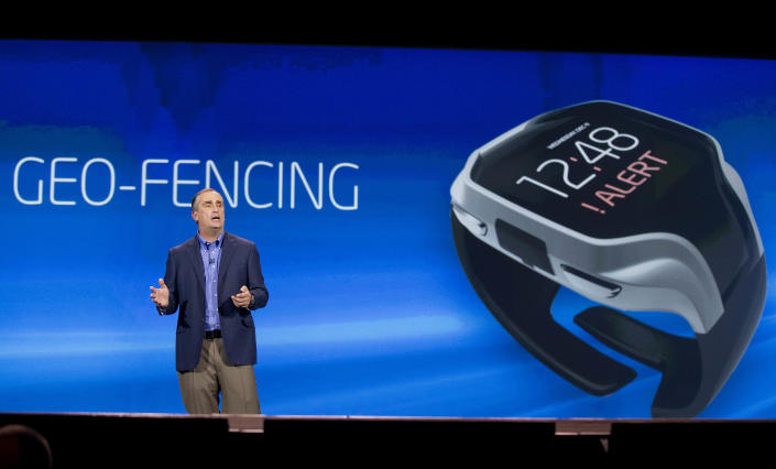 Intel CEO Brian Krzanich talks about geo-fencing in a wearable tracker during a keynote address at the Consumer Electronics Show, Monday, Jan. 6, 2014, in Las Vegas. (AP Photo/Julie Jacobson)