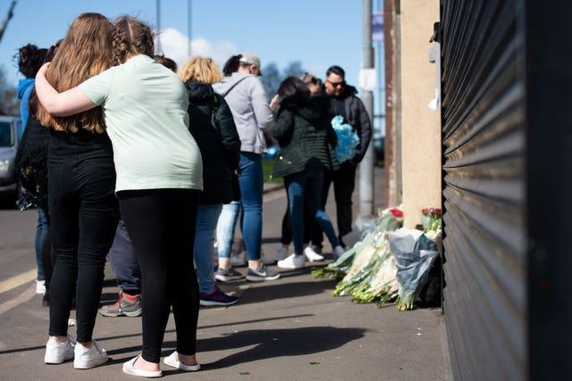 Flowers and tributes are left at the scene on High Street, Brownhills, near Walsall in the West Midlands
