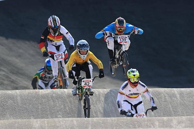 LONDON, ENGLAND - AUGUST 09: Brian Kirkham (C) of Australia races during the Men's BMX Cycling Quarter Finals on Day 13 of the London 2012 Olympic Games at BMX Track on August 9, 2012 in London, England. (Photo by Phil Walter/Getty Images)