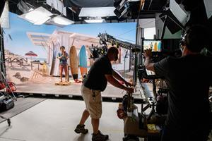 "A production crew works on a shoot for Salesforce at an xR (Extended Reality) Stage in Marin, Calif. on Oct. 26, 2020. At the xR Stage, brands can continue to produce high-quality marketing and communications content ""set"" anywhere — with higher degrees of COVID-19 safety, convenience and creative control. (Peter Barreras/AP Images for Salesforce)"