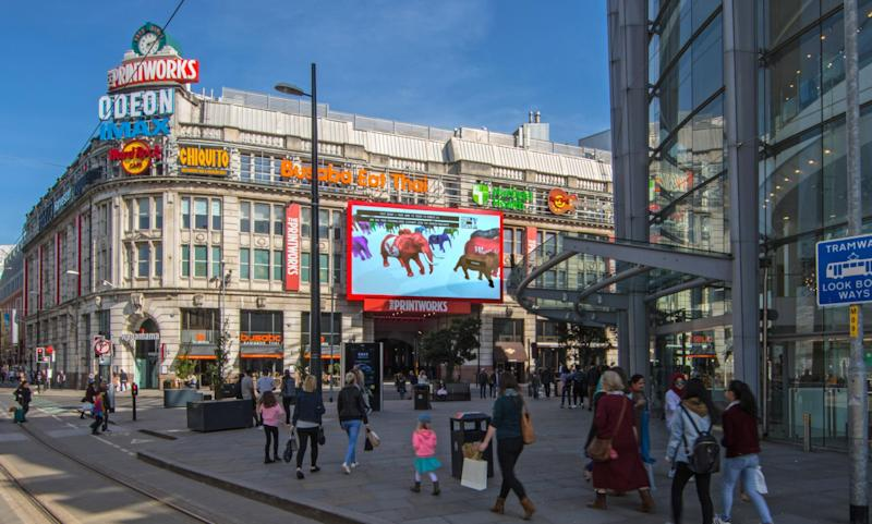 A digital elephant sponsored by The Independent appears on screen in Manchester