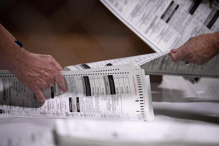 Test ballots are hand counted on July 14, 2021, in the Wesley Bolin Building at the Arizona State Fairgrounds in  Phoenix.
