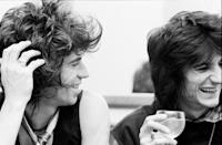 <p>The Rolling Stones bandmates, Keith Richards and Ronnie Wood, laugh over drinks backstage at Madison Square Garden in 1979. </p>