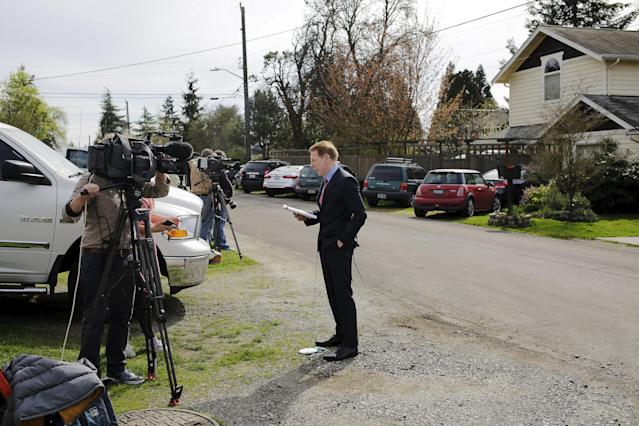 "A television reporter works outside the home of Amanda Knox's mother in Seattle, Washington March 27, 2015. A Seattle-based representative for Amanda Knox said he was ""overjoyed"" after her acquittal for the 2007 murder of British student Meredith Kercher by Italy's top court on Friday, adding that ""the truth has won out."" REUTERS/Jason Redmond"