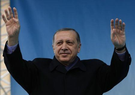 Turkish President Erdogan greets his supporters during a rally for the upcoming referendum in the Black Sea city of Rize