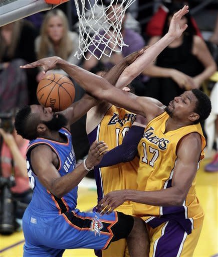 Oklahoma City Thunder's James Harden, left, gets his shot blocked as he is defended by Los Angeles Lakers' Andrew Bynum, right, and Pau Gasol, of Spain, during the second half in Game 4 of an NBA basketball playoffs Western Conference semifinal in Los Angeles, Saturday, May 19, 2012. (AP Photo/Jae C. Hong)
