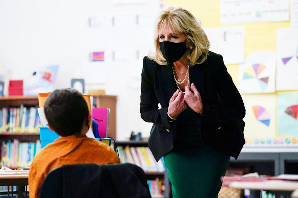 US First Lady Jill Biden speaks with students in Becky Taylors classroom as she visits the Christa McAuliffe School in Concord, New Hampshire, on March 17, 2021