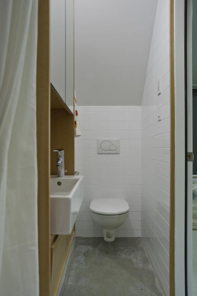 <p>Powder room near the garage. (LaneFab) </p>