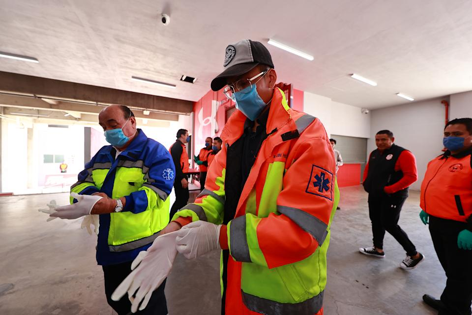 Medical personal wearing face mask during the 10th round match between Toluca and Atlas as part of the Torneo Clausura 2020 Liga MX at Nemesio Diez Stadium on March 15, 2020 in Toluca, Mexico. The match is played behind closed doors to prevent the spread of the novel Coronavirus (COVID-19). (Photo by Hector Vivas/Getty Images)
