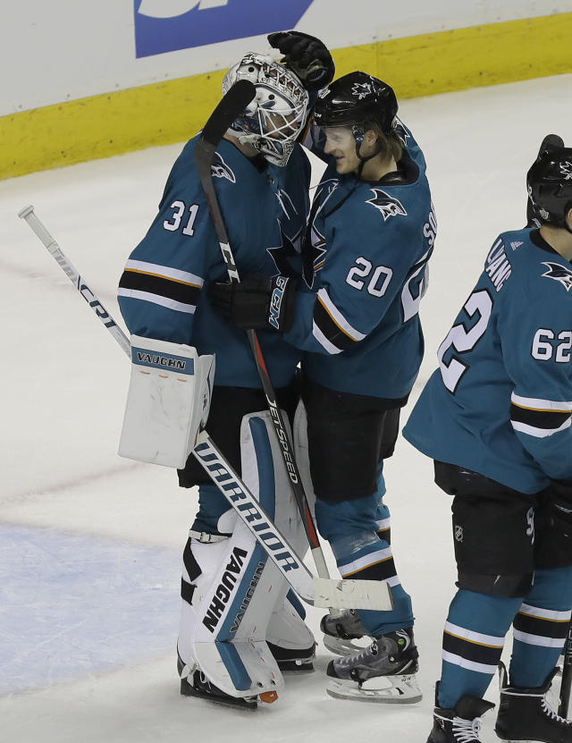 San Jose Sharks goalie Martin Jones (31) and left wing Marcus Sorensen (20), from Sweden, celebrate after the Sharks beat the Anaheim Ducks 8-1 in Game 3 of an NHL hockey first-round playoff series in San Jose, Calif., Monday, April 16, 2018. (AP Photo/Jeff Chiu)