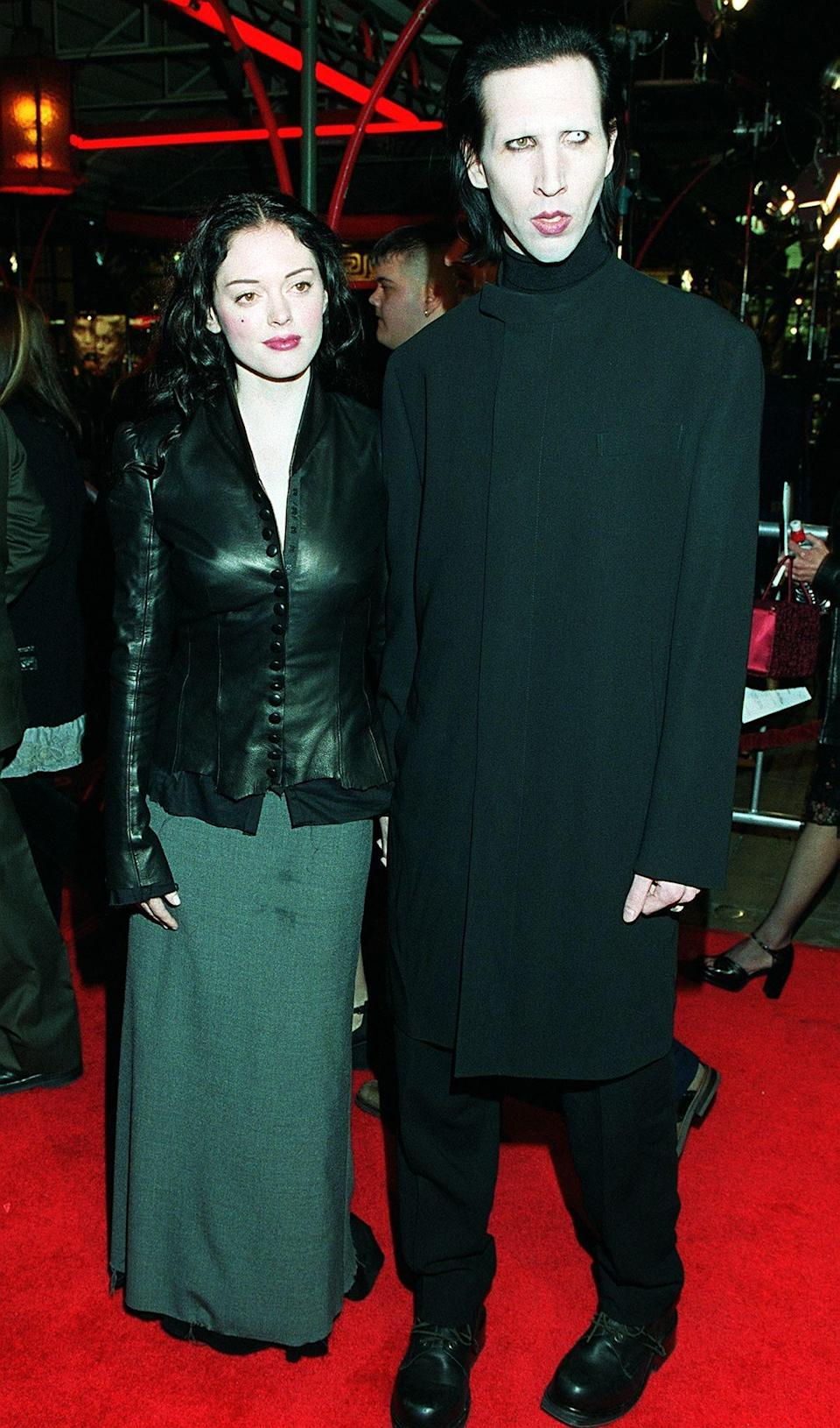 "Marilyn Manson arrives at the premiere of Tim Burton's film ""Sleepy Hollow"" with Rose McGowan in Los Angeles, Nov. 17, 1999."