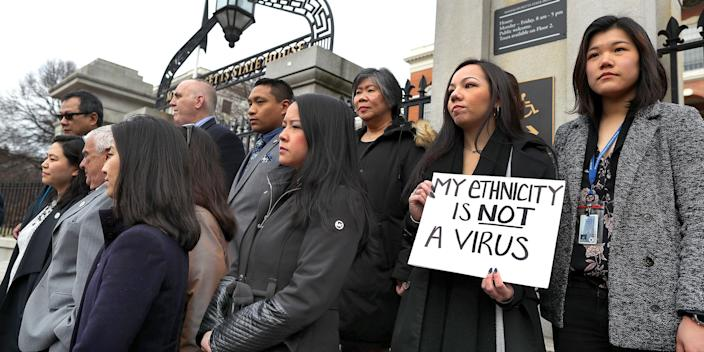 Members of the Asian American Commission hold a press conference on the steps of the Massachusetts State House to condemn racism towards the Asian American community because of coronavirus on March 12, 2020 in Boston.