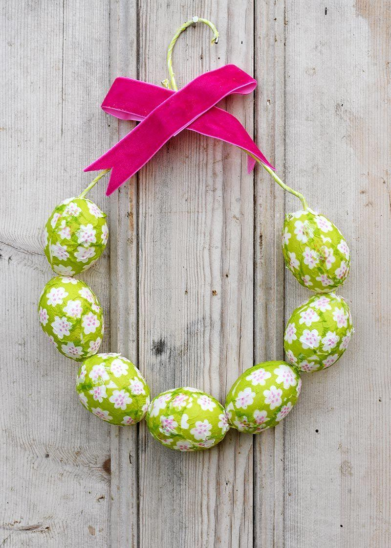 """<p>For an Easter wreath that has a one-of-a-kind vibe, make this one that wraps in Marimekko-inspired paper napkins, Mod Podge, and an old wire coat hanger. </p><p><strong>Get the tutorial at <a href=""""https://www.pillarboxblue.com/marimekko-easter-egg-wreath/"""" rel=""""nofollow noopener"""" target=""""_blank"""" data-ylk=""""slk:Pillar Box Blue"""" class=""""link rapid-noclick-resp"""">Pillar Box Blue</a>.</strong></p><p><a class=""""link rapid-noclick-resp"""" href=""""https://go.redirectingat.com?id=74968X1596630&url=https%3A%2F%2Fwww.walmart.com%2Fip%2FPlaid-Mod-Podge-Matte-16-oz%2F17472599&sref=https%3A%2F%2Fwww.thepioneerwoman.com%2Fhome-lifestyle%2Fcrafts-diy%2Fg35698457%2Fdiy-easter-wreath-ideas%2F"""" rel=""""nofollow noopener"""" target=""""_blank"""" data-ylk=""""slk:SHOP MOD PODGE"""">SHOP MOD PODGE</a></p>"""