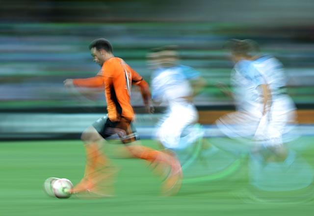 <p>Corey Brown of the Roar runs with the ball during the round 19 A-League match between Melbourne City FC and the Brisbane Roar at AAMI Park </p>