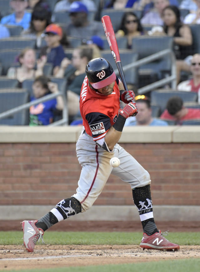 Washington Nationals' Adam Eaton is hit by a pitch during the seventh inning of a baseball game against the New York Mets, Saturday, Aug. 25, 2018 in New York. (AP Photo/Bill Kostroun)