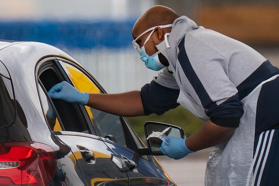Medical staff at an NHS drive through coronavirus disease (COVID-19) testing facility in an IKEA car park, Wembley as the UK continues in lockdown to help curb the spread of the coronavirus.