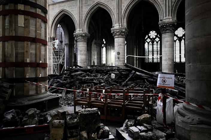 Damages and rubble are pictured during preliminary work inside the Notre Dame de Paris Cathedral, May 15, 2019 in Paris. (Photo: Philippe Lopez/Pool via AP)