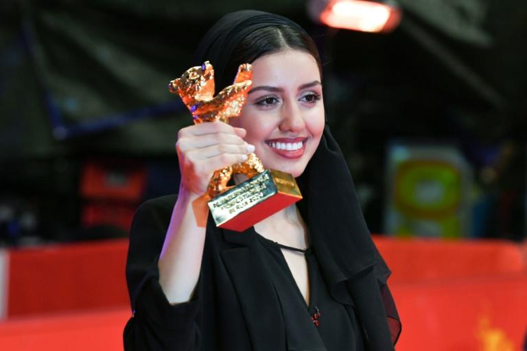Iranian actress Baran Rasoulof posed with the trophy 'Golden Bear for Best Film', on behalf of her father, director and producer Mohammad Rasoulof, who is not allowed to leave Iran