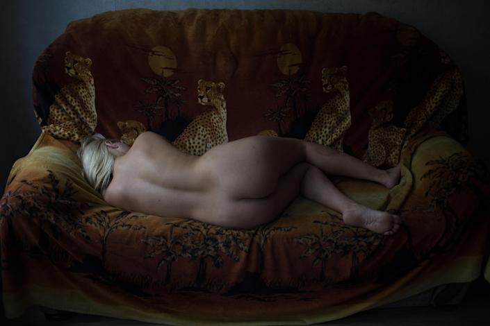 <p>Girls: Alena (33) was born in Ukraine and raised in an orphanage. She moved from Donetsk to St Petersburg after the war in Ukraine, thinking that she was being offered work as an administrator in a brothel, only to find that the job was as a sex worker, Sept. 22, 2017.<br>Sex workers pictured in their apartments, in St Petersburg, Russia. Official statistics say that there are one million sex workers in Russia. Silver Rose, a St Petersburg NGO, puts that at closer to three million, with more than 50,000 women working in St Petersburg alone. Prostitution is illegal in Russia, and though fines are not large (about €28) women are vulnerable to extortion because they fear the consequences of having a criminal record.<br>According to Silver Rose, despite the stereotypical view of sex workers, only a small percentage have taken to prostitution because they are addicts or living in extreme poverty. The decline of the Russian economy has led to a growing number of women — many over the age of 35 — who have lost jobs in such fields as business or education becoming sex workers. (Photo: Tatiana Vinogradova) </p>
